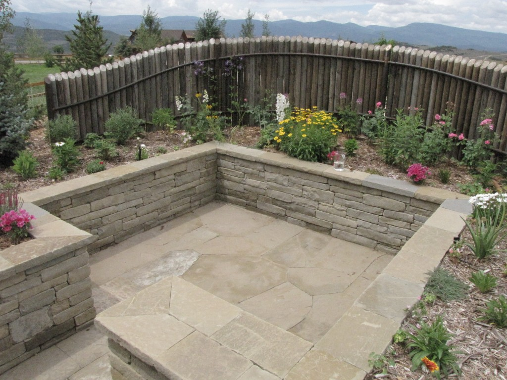 Sunken Patio Perennial Garden Providing Shelter And Intimacy. Random  Flagstone Patio On Sand With Tight Joints.
