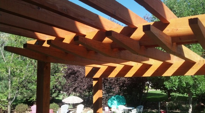 A stepped pergola detail creates elegant shadow lines.