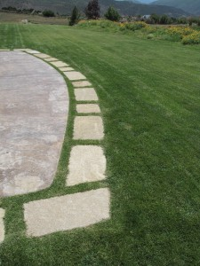 Flagstone border to stamped concrete patio