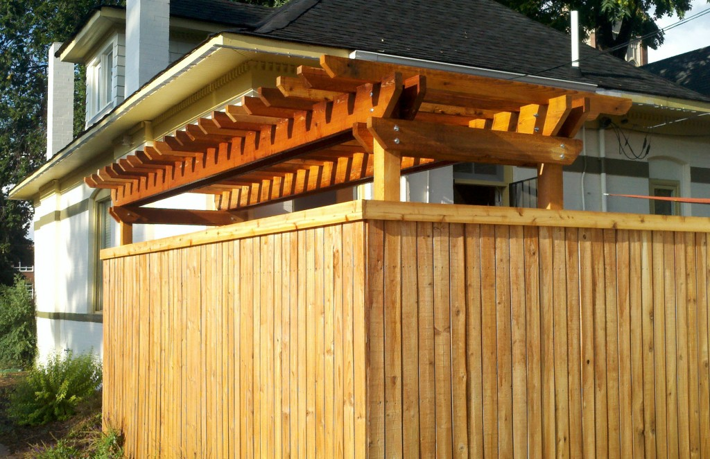 Cedar pergola provides shade to create an urban oasis.